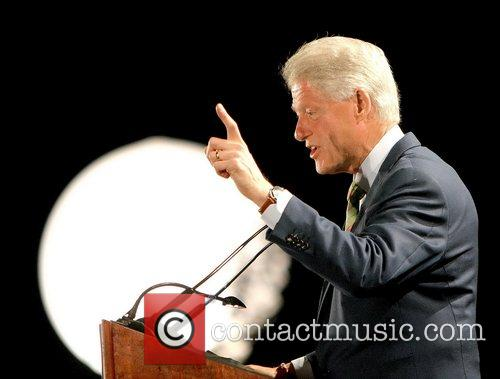 Bill Clinton, Andre Agassi and Hillary Clinton 10