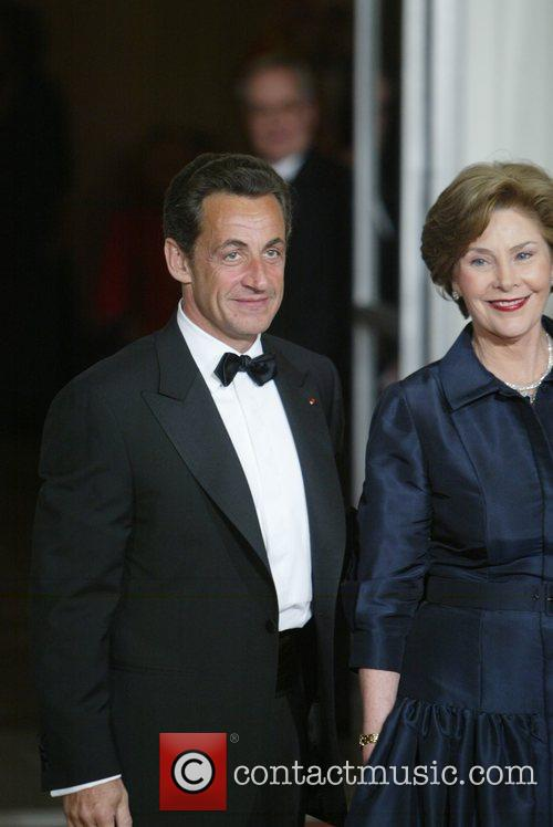 French President Nicolas Sarkozy and First Lady Laura...