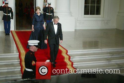 First Lady Laura Bush and President George Bush...