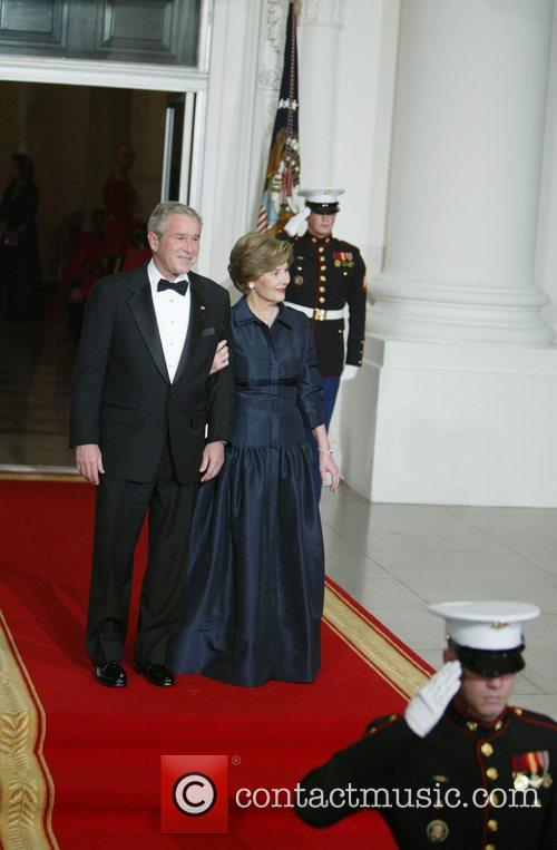 President George Bush and First Lady Laura Bush...