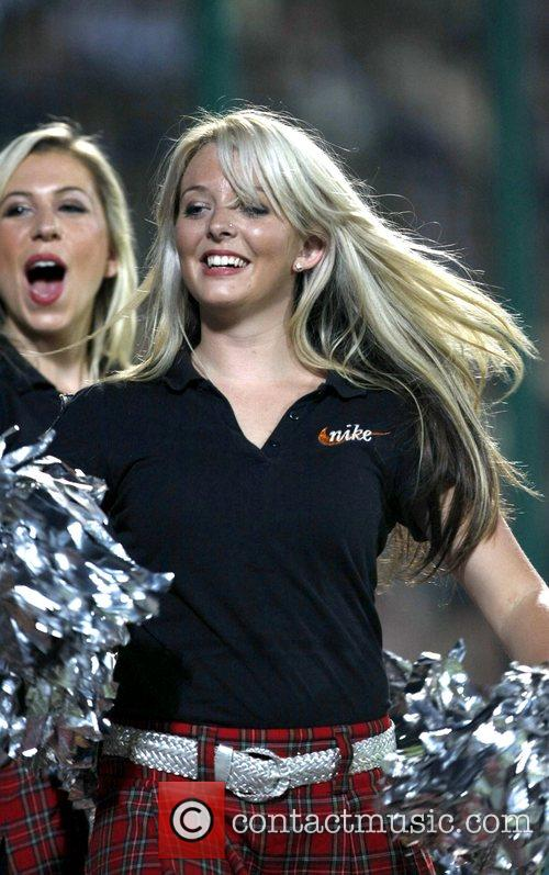 Deccan Chargers cheerleaders  perform during the match...
