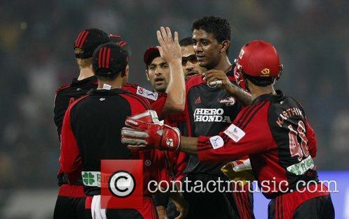 Delhi Daredevils Farveez Maharoof (2nd R) celebrates with...