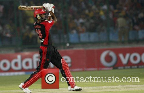 Plays a shot during the match against Deccan...
