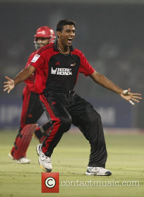 Delhi Daredevils Farveez Maharoof  celebrates wicket of...