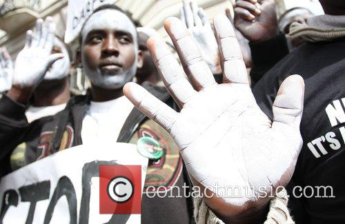 Over 3,000 protesters gather outside the Sudanese Embassy...