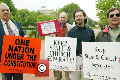 Atheists protest outside the White House, during National...