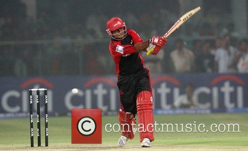 Delhi Daredevils captain Virender Sehwag plays a shot...