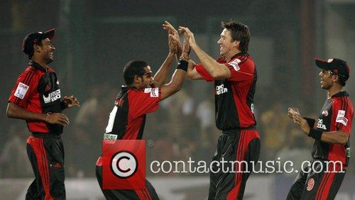 Glenn McGrath Delhi Daredevils 2nd right celebrates with...