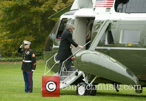 President George Bush leaving The White House with...