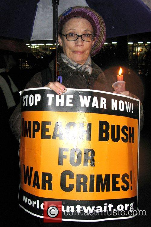 Anti-war protesters commemorate the fifth anniversary of the...