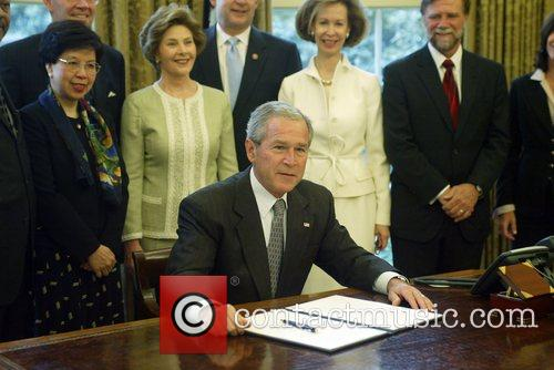 President George Bush signing a bill for Malaria...