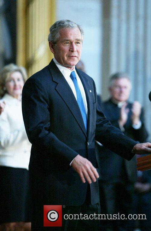 President Bush on hand to present Dr. Michael...