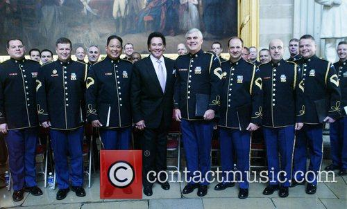 Wayne Newton and the US Military Band were...