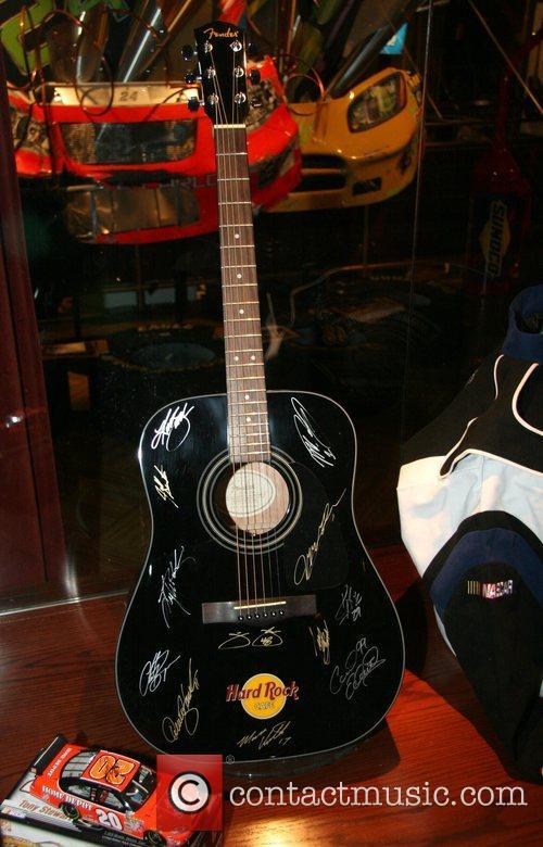Nascar driver autographed guitar Nascar fan fest at...