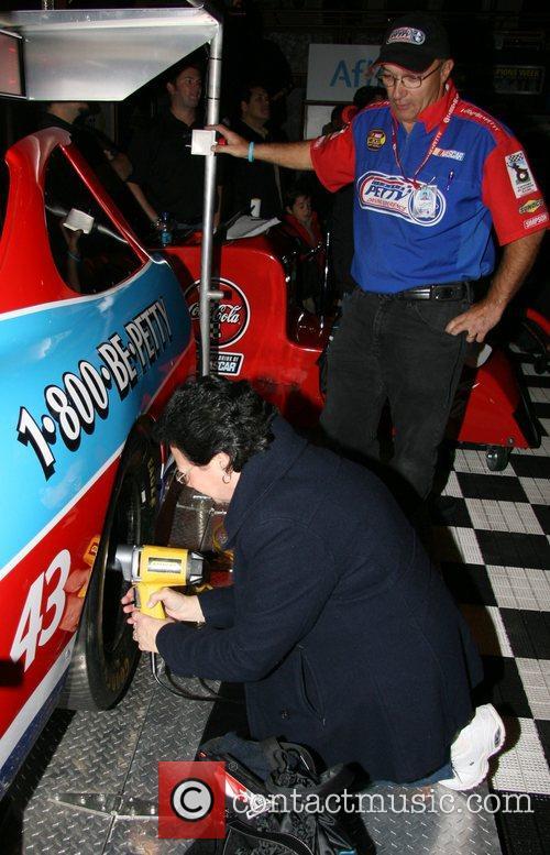 Nascar fan changes a tire Nascar fan fest...