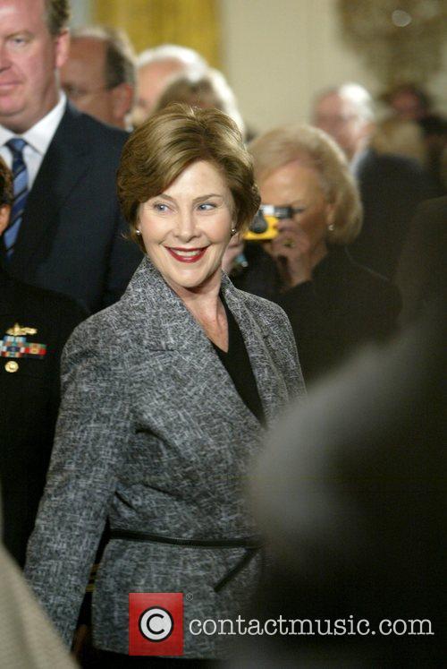 First Lady Laura Bush President George W. Bush...