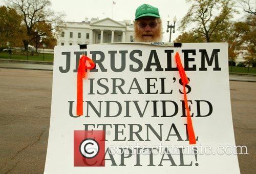 Protestor Israeli Prime Minister Ehud Olmert is heckled...