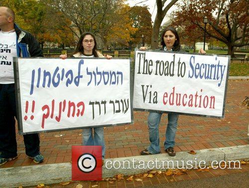 Protestors Israeli Prime Minister Ehud Olmert is heckled...