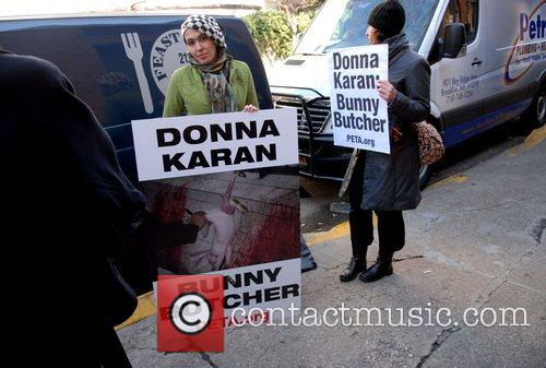 PETA protestors stand outside the DKNY fashion show...