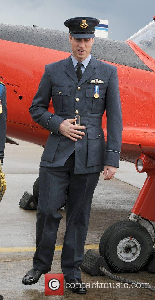 Prince William poses following his graduation ceremony at...
