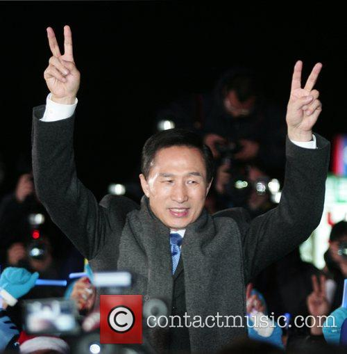 South Korean President elect Lee Myung-bak waves to...