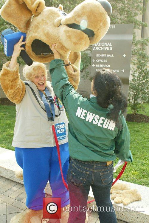The Newseum Mascot and escort take a break...