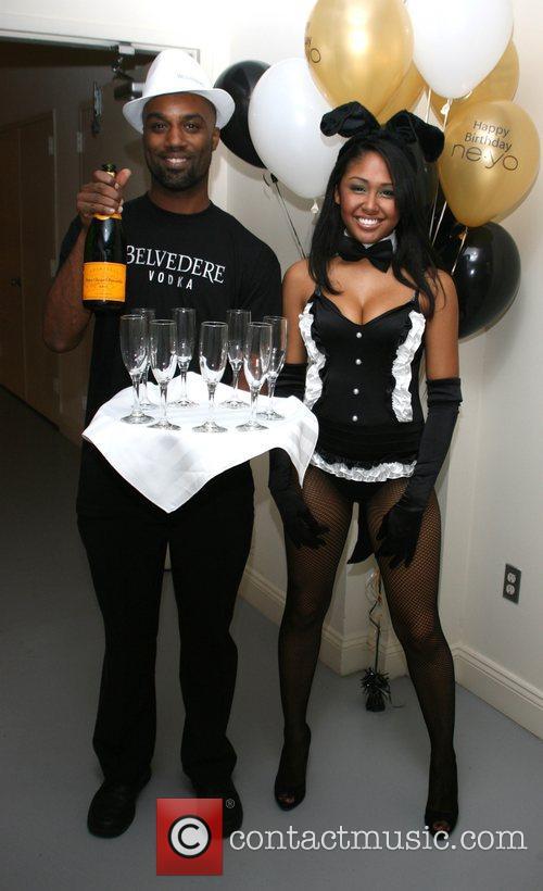 Jason Johnson and Mitsue Burnett Ne-Yo celebrates his...