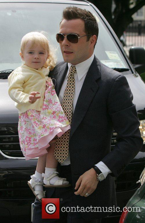 Shane Filan with daughter Nicole at the christening...