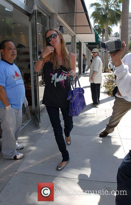 Goes on a shopping spree in Beverly Hills...