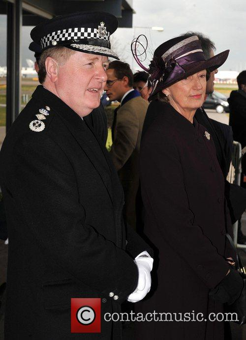 Sir Ian Blair with his wife French president...