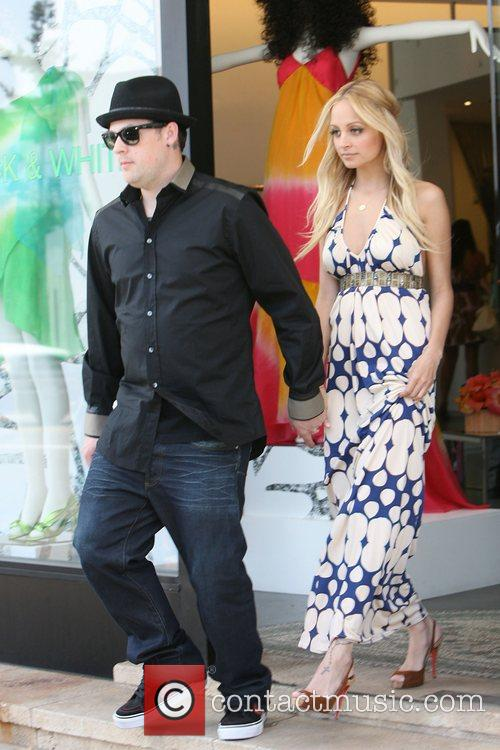 Nicole Richie and Joel Madden outside their shop...