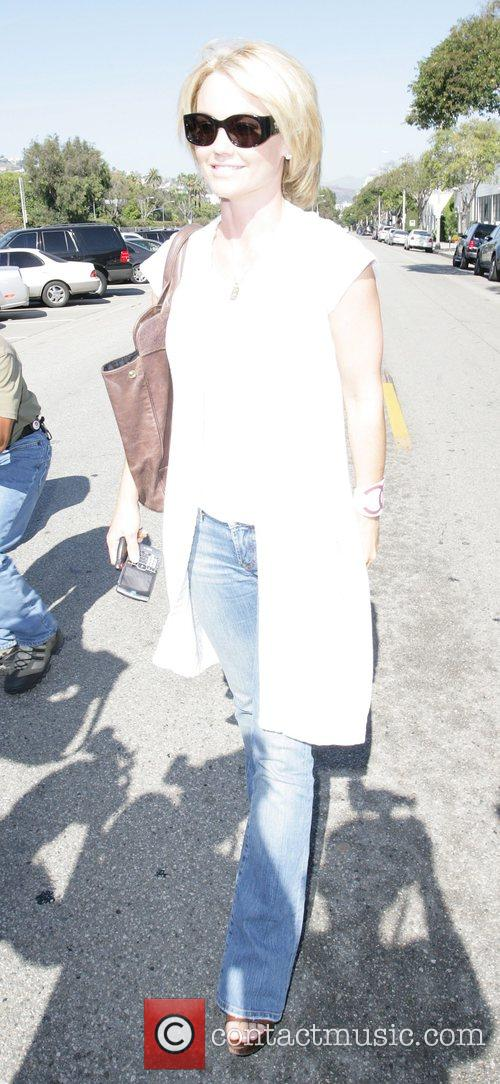 Nip/Tuck actress Kelly Carlson, 31, leaves the Neil...