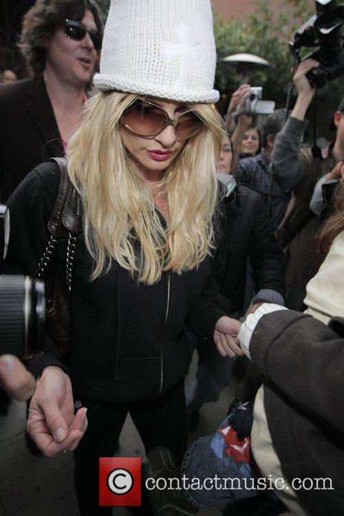 Nicolette Sheridan  is surrounded by paparazzi when...