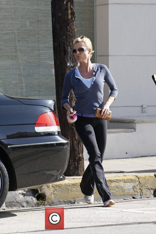 Nicollette Sheridan runs to her car