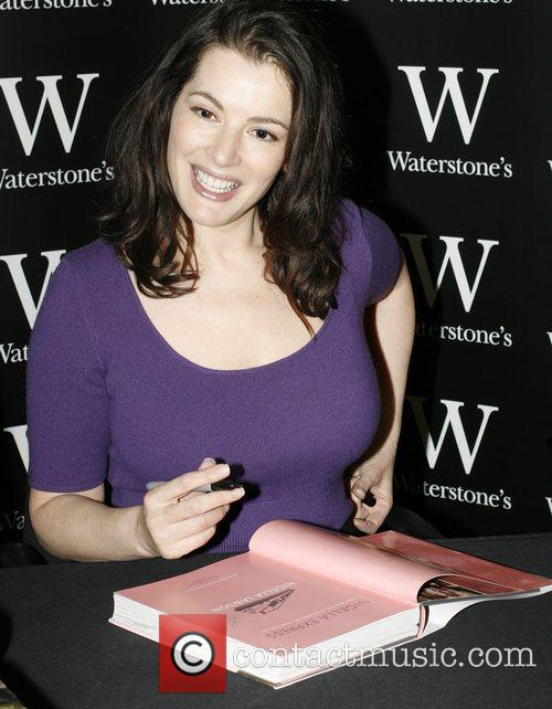 Signs copies of her new book