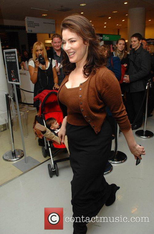 Nigella Lawson signs copies of her new book...