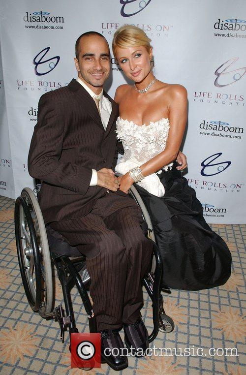 Jesse Billauer and Paris Hilton The 4th Annual...