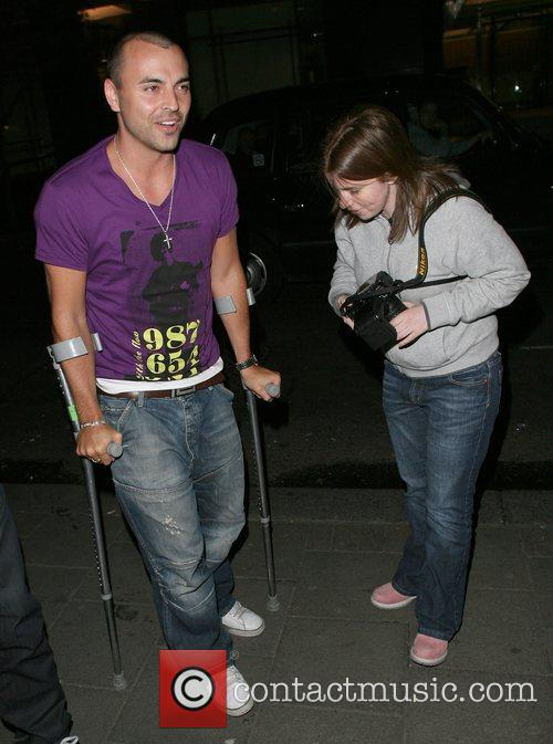 Andy Scott-Lee on crutches leaving the Embassy nightclub,...