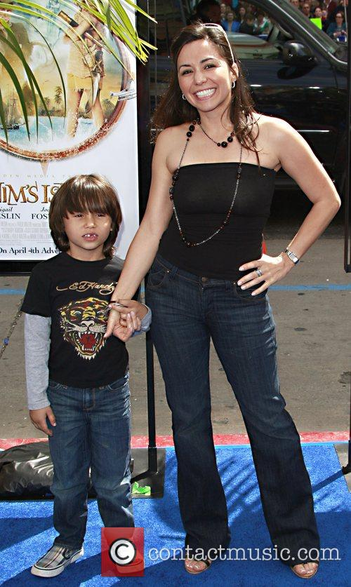 Jennifer Behrens and son arrive at the premiere...