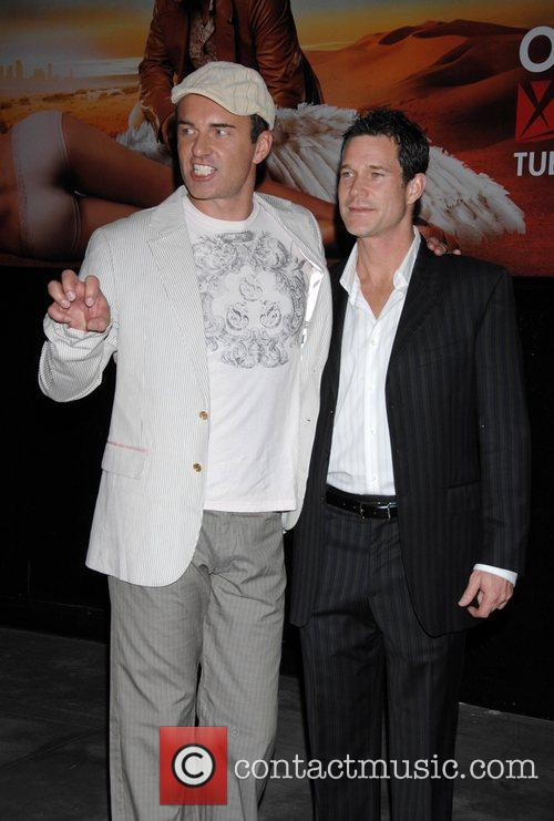 Julian McMahon and Dylan Walsh Celebrating nip/tuck's move...