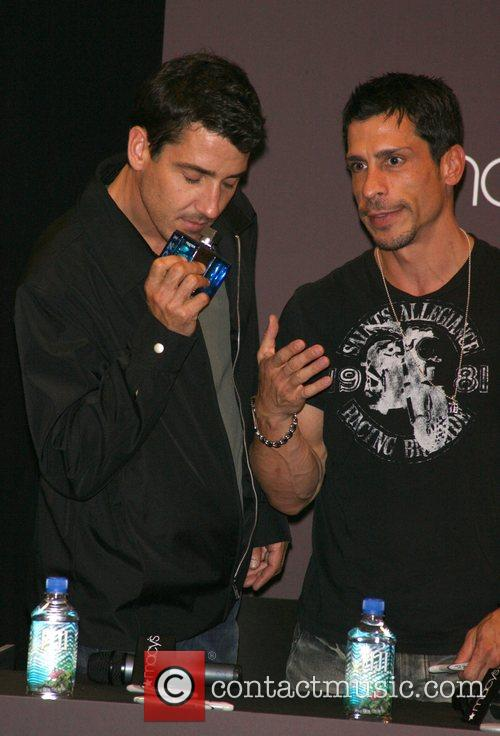 Jonathan Knight and Danny Wood test an IZOD...
