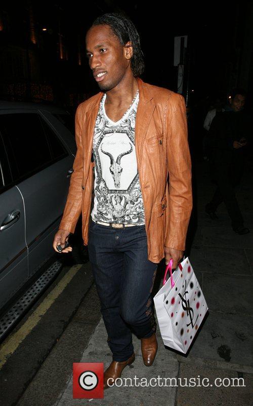 Didier Drogba, Chelsea, Ivory Coast Striker Leaving Nobu Berkeley Street Restaurant and Carrying A Yves Saint Laurent Bag. 3