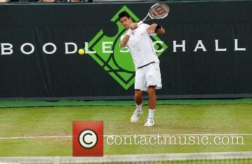 Tennis player Novak Djokovic plays against Jamie Baker...