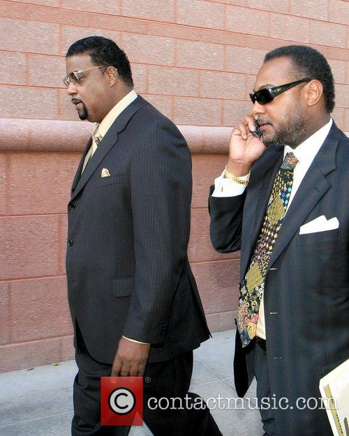 Co-defendant Clarence Stuart, left, arrives with his attorney...