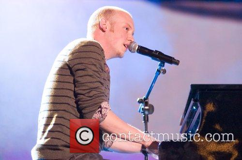 Isaac Slade of The Fray on stage at...
