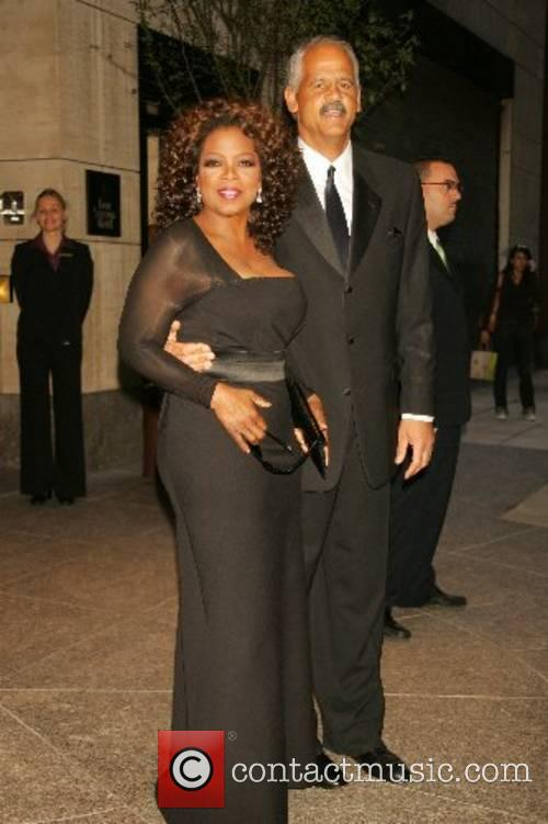 Oprah Winfrey with Stedman Graham leaving her hotel...