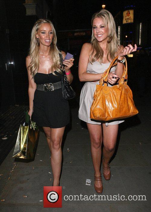 Lauren Pope and a female friend leaving the...