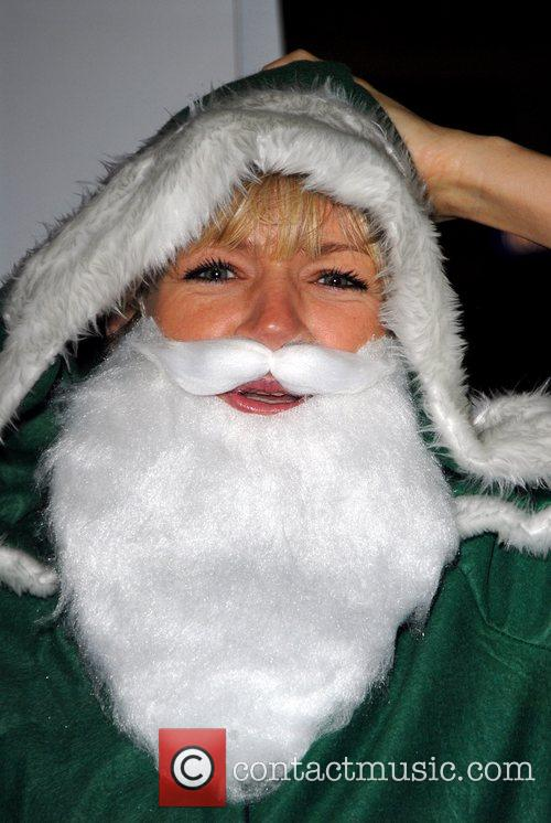 Zoe Ball posing in a green Father Christmas...
