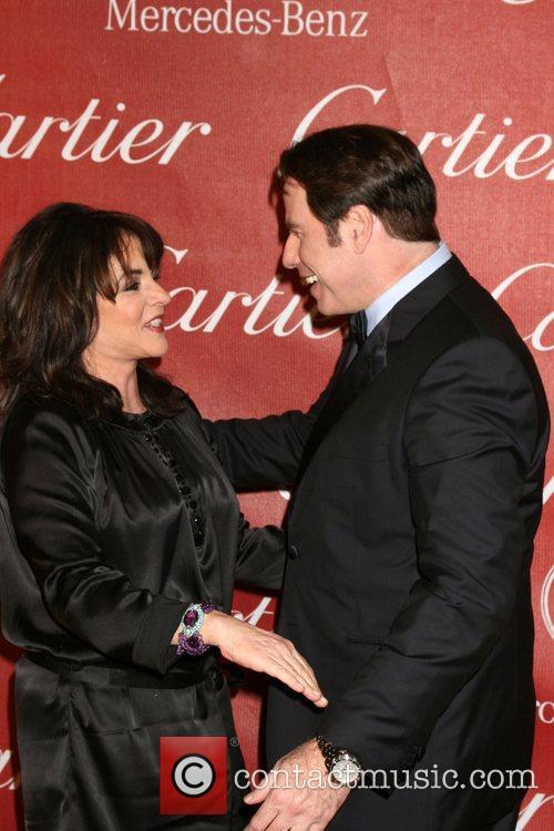 Stockard Channing and John Travolta 19th annual Palm...