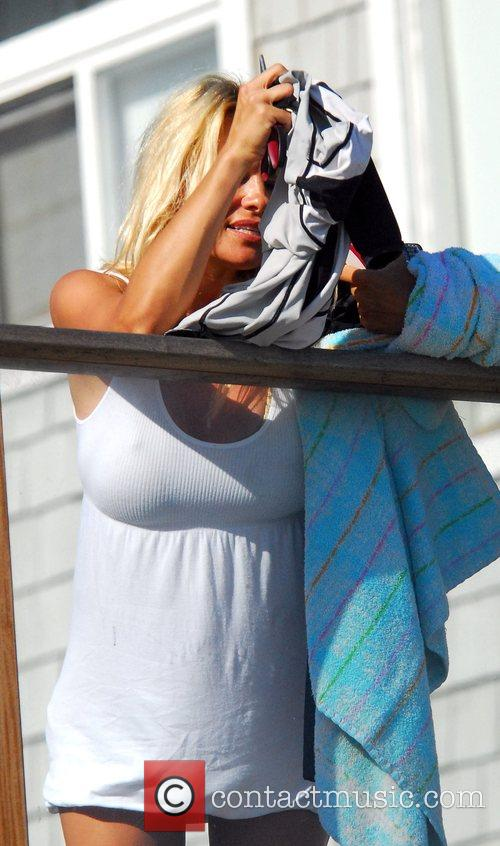 Pamela Anderson sunbathing at her beach house in...